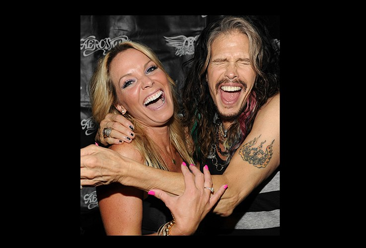 Woman smiling with Steven Tyler