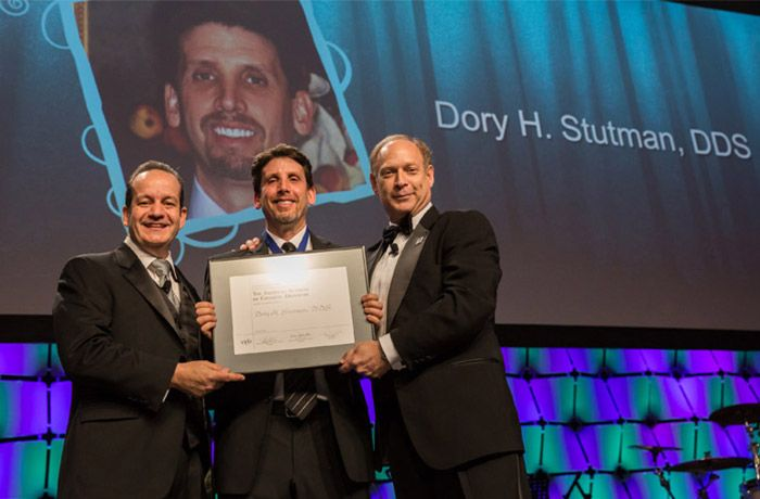 Dr. Stutman receiving cosmetic dentistry accreditation