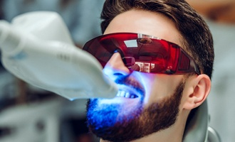 A young man having his teeth whitened in-office