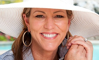 Smiling woman in large sun hat