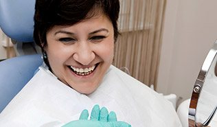 Laughing woman in dental chair