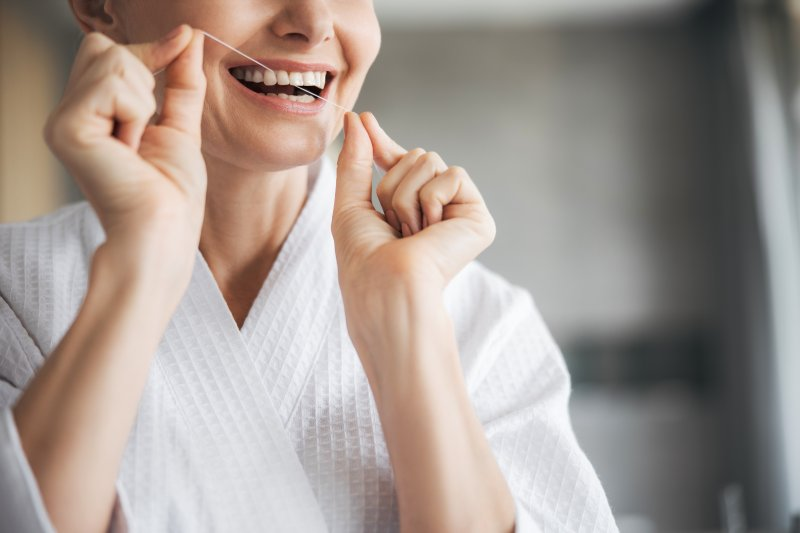 Closeup of female holding dental floss