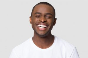 man smiling getting answers to Invisalign questions
